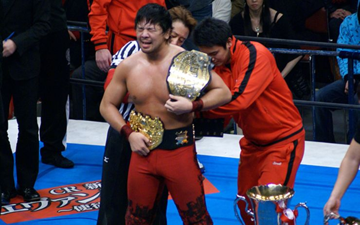 Shinsuke Nakamura with both the IWGP Heavyweight and IGF's IWGP Heavyweight Championship titles.